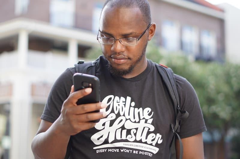 Man using mobile phone. Photo by Alex Nemo Hanse