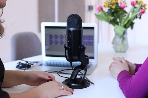 Two women podcasting with minimal equipment